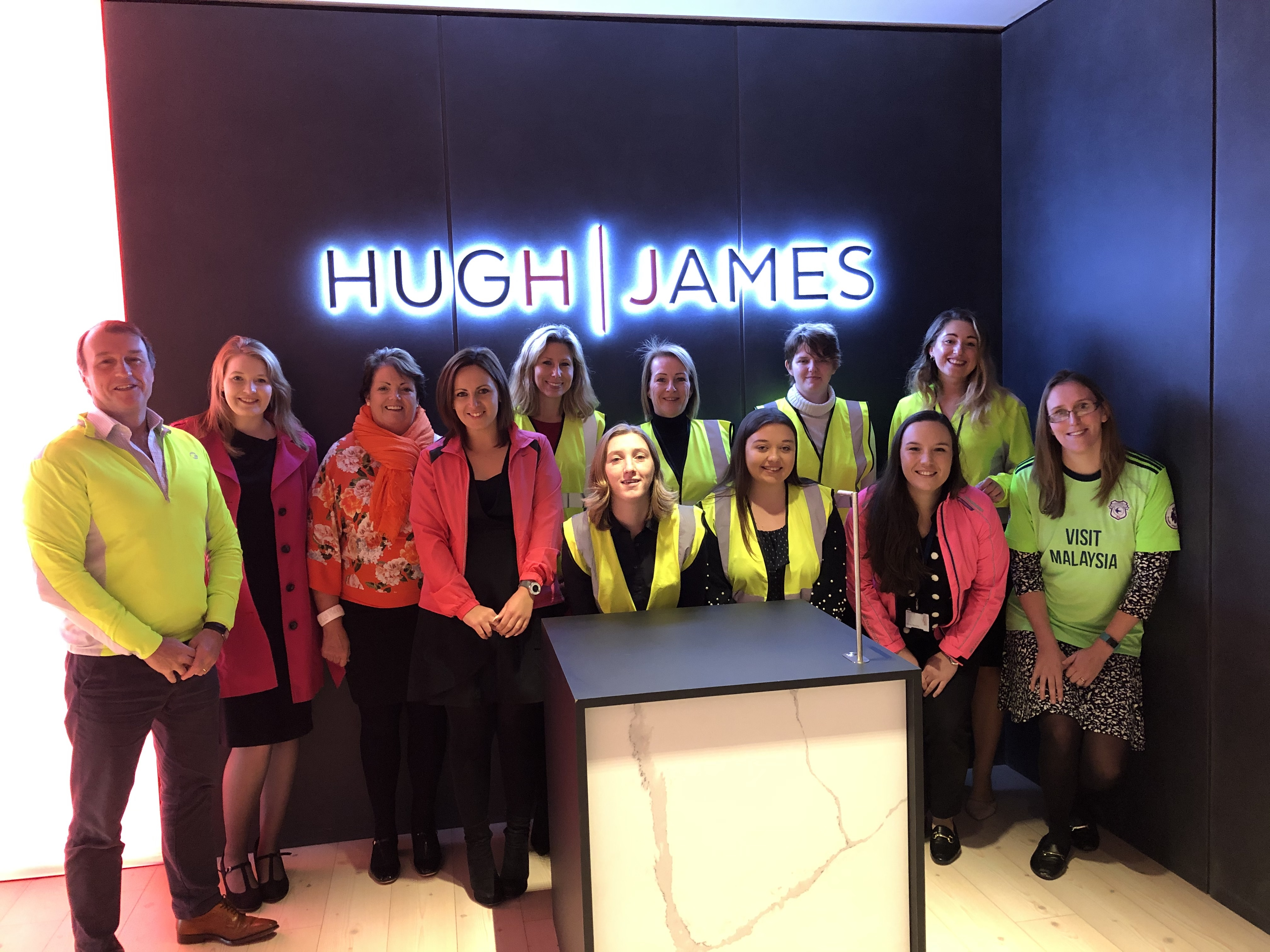 The Hugh James Brain and Spinal Cord Injury Team wearing fluorescent colours to support GloWeek